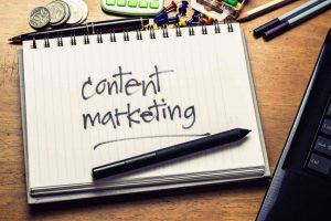 'content marketing' written out on a notebook