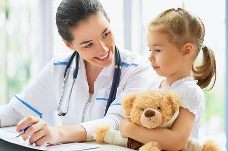 pediatrician doctor examining a child in a hospital