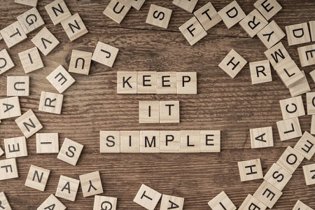 scrabble tiles spelling out 'keep it simple'