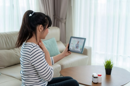 Woman having a telehealth appointment on tablet