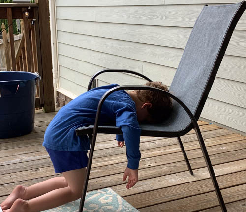 The author's son face-down in a deck chair