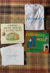 WriterGirl branded baby onesie with two children's books