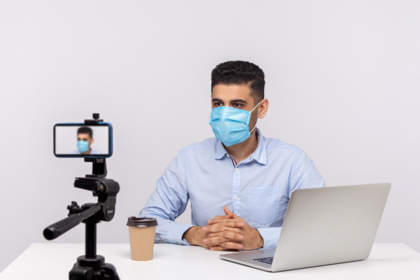Doctor recording a healthcare video on a phone