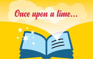 Open story book with the text 'once upon a time'